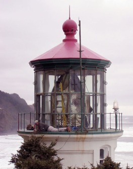 Cullen Chambers inspects metal components of the Heceta Head Lighthouse lantern, 2001