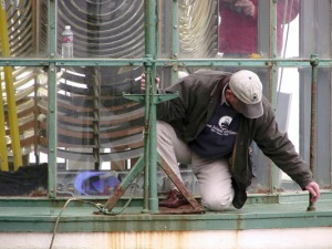 Cullen inspects the metalwork on Heceta Head Lighthouse's lantern