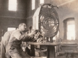 A lampist at work in the depot's lamp shop. All Fresnel lenses were shipped through the depot. Most testing and repairs of lighthouse equipment took place at the depot. 1930 photograph courtesy of U.S. Coast Guard.