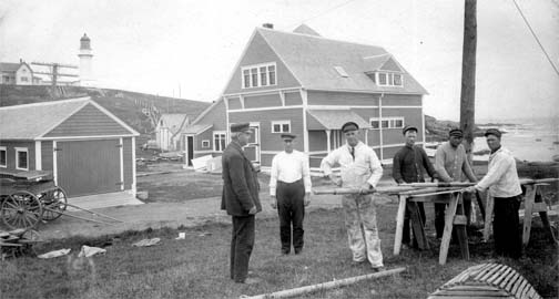 Cape Elizabeth Lifesaving Station, Maine.  Note one of the twin lighthouse towers in the background. Photo courtesy of U.S. Coast Guard